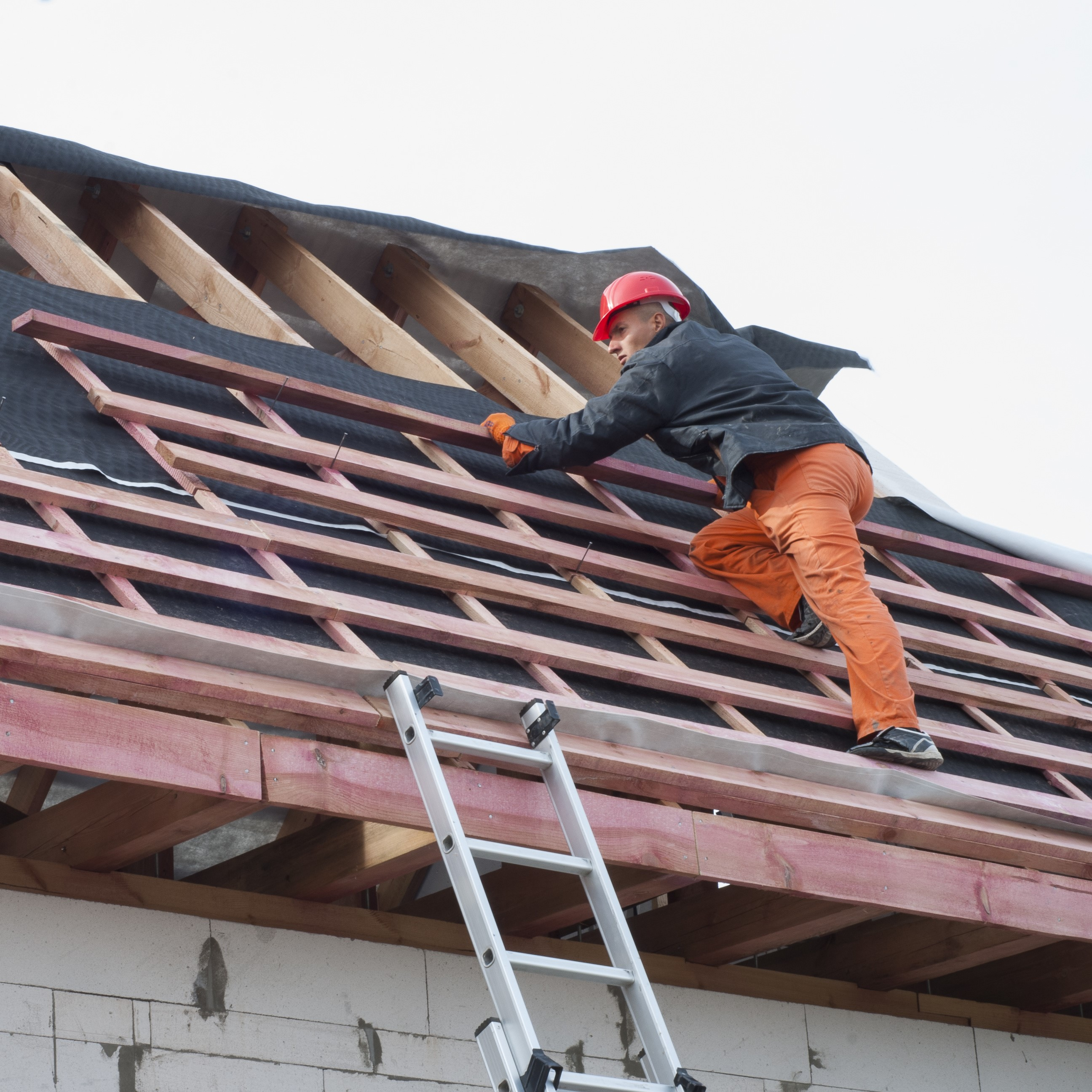 A roofer doing repairs on roof.