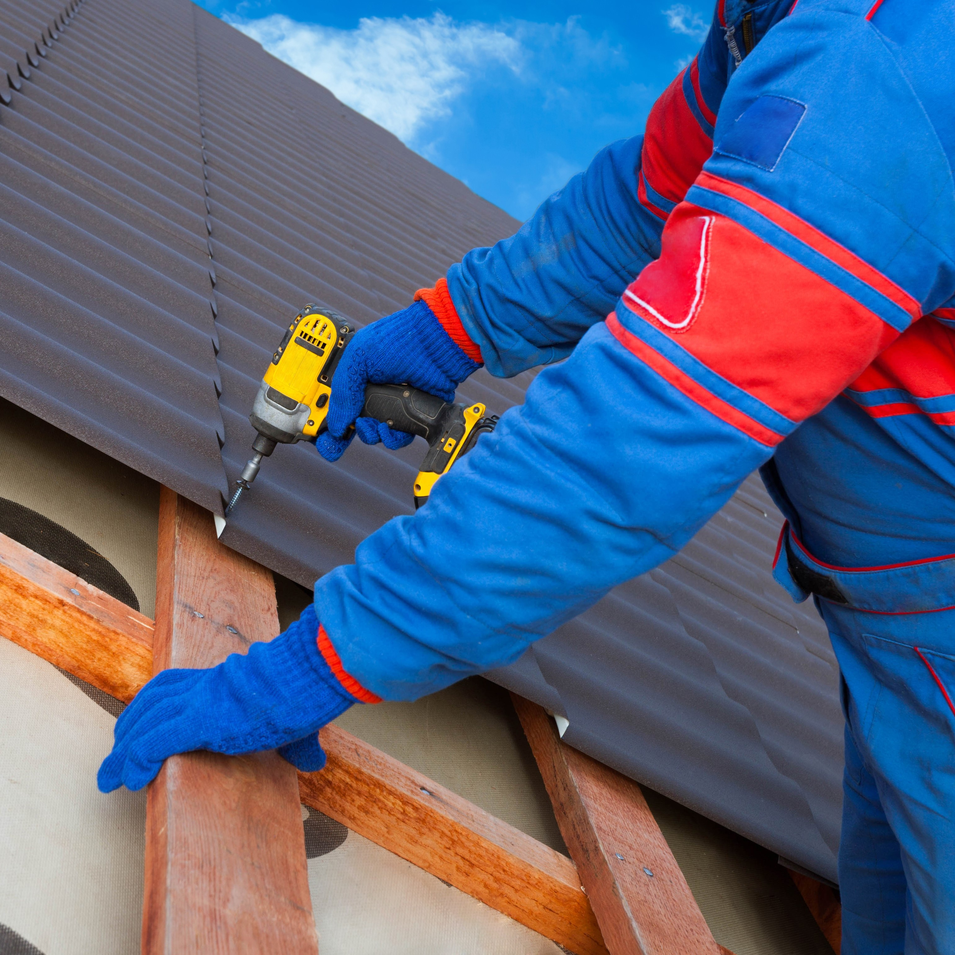 A roofer installing a roof.