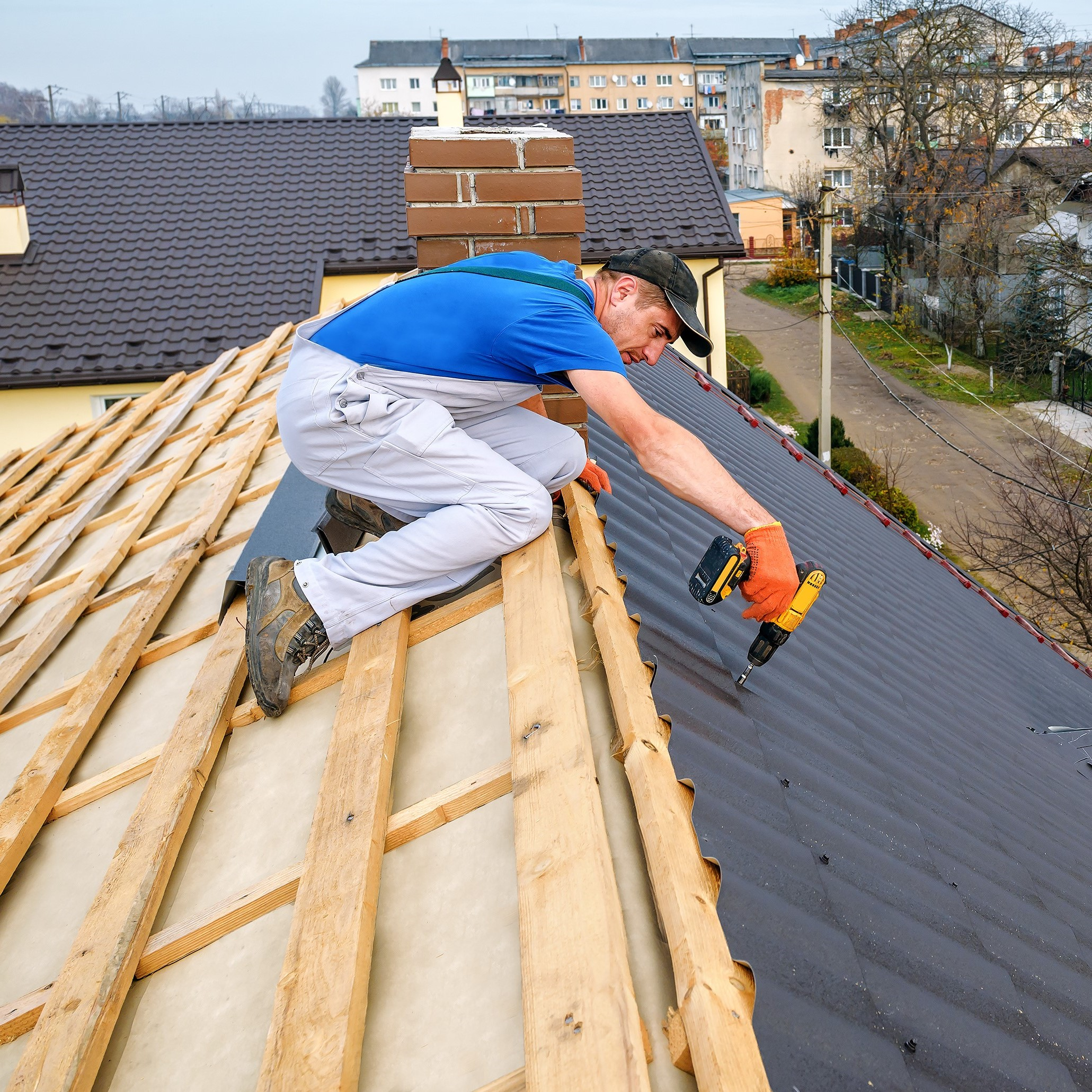 A roofer fixing a roof.