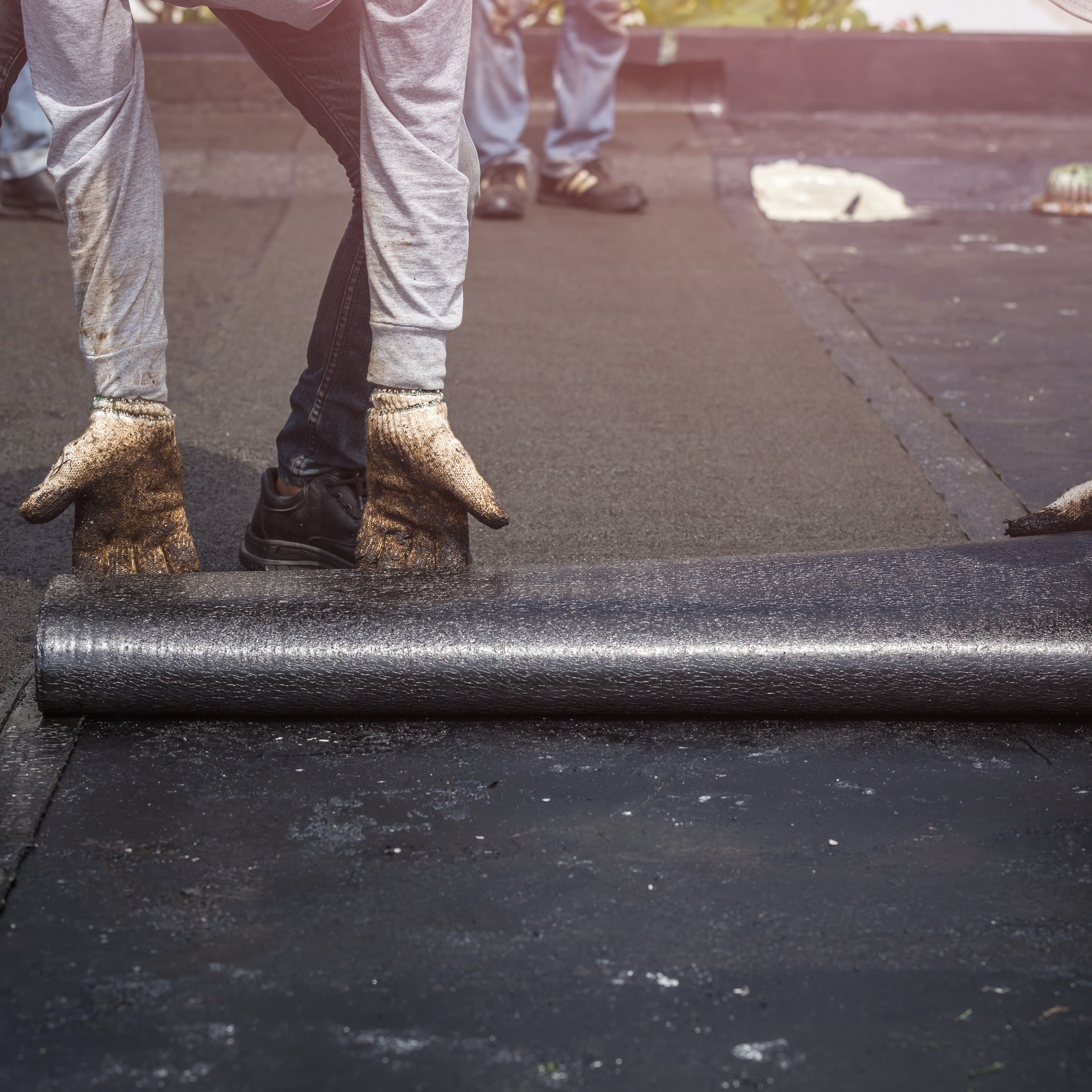 TPO membrane being installed on a roof.